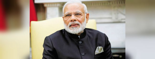 Narendra Modi claims a histroric landslide victory