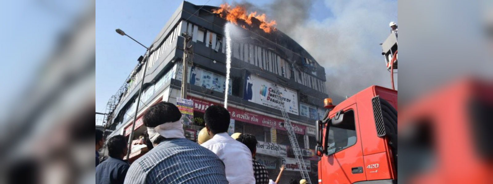 Indian police file case against three over coaching center fire, death toll rises to 20