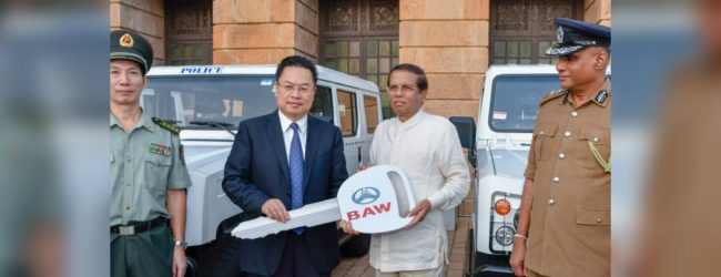 Chinese government presents 10 SUVs to Sri Lanka Police