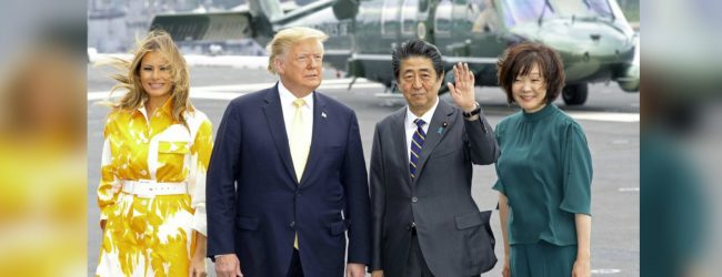 U.S. President Donald Trump inspects Japanese destroyer