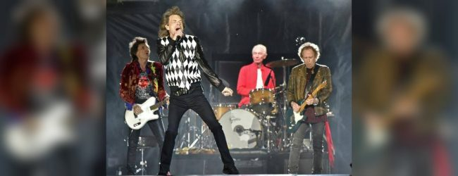 Mick Jagger back on stage following heart surgery