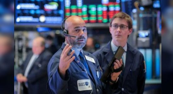 Wall St sinks as hopes fade for rate cuts, trade progress