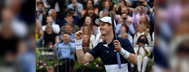 Andy Murray marks a successful return with doubles win