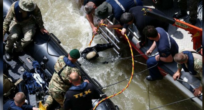 Rescue workers battle with strong river currents in Danube accident search