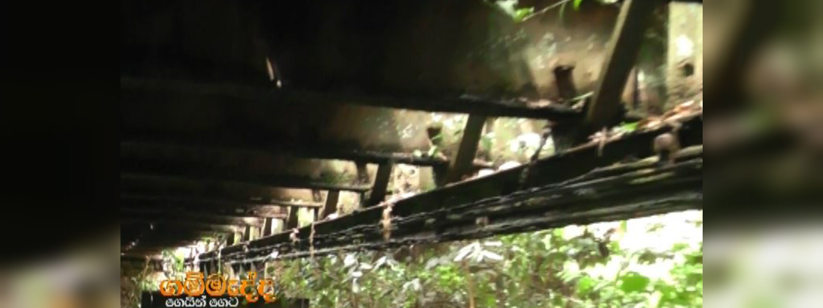 Villagers put lives on the line crossing ricketty 40 year old bridge