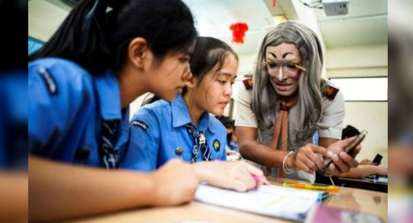 Thai English teacher puts on outrageous makeup to boost students' confidence in class