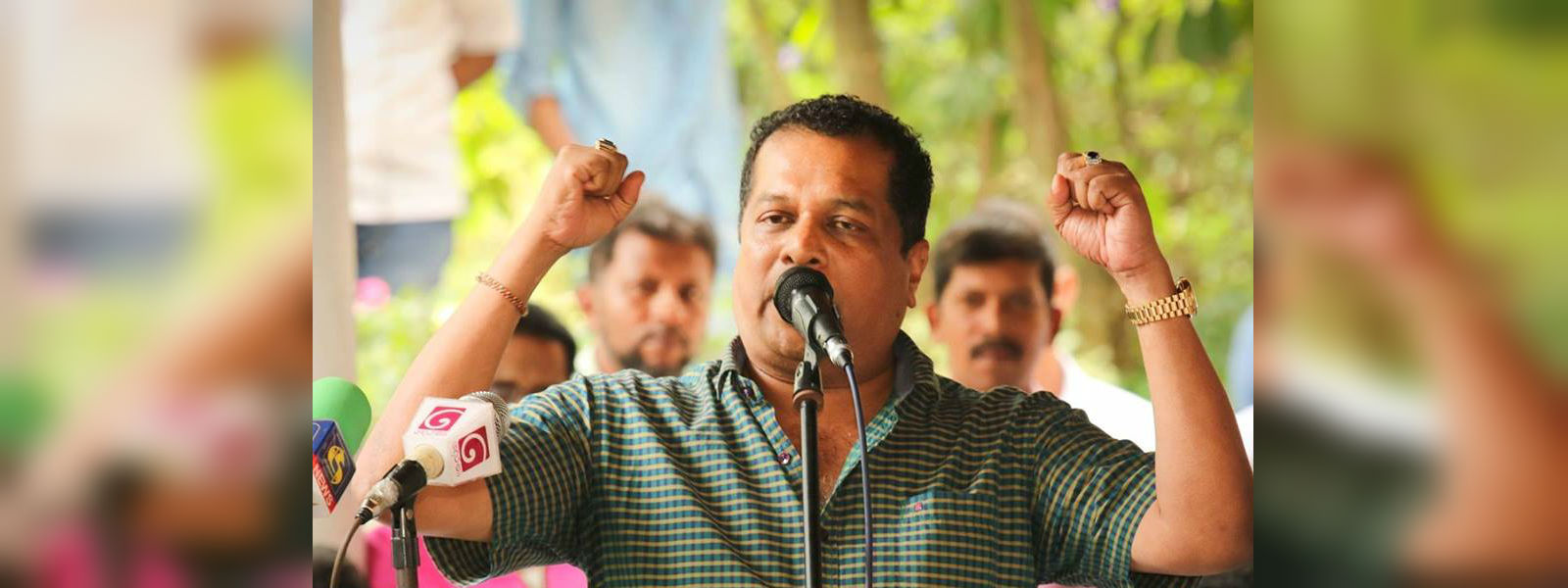 The symbol will be either elephant or swan: MP J. C. Alawathuwala