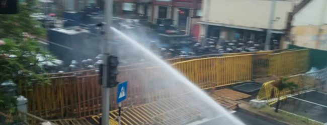 Police fire tear gas and water cannons to disperse protesting university students
