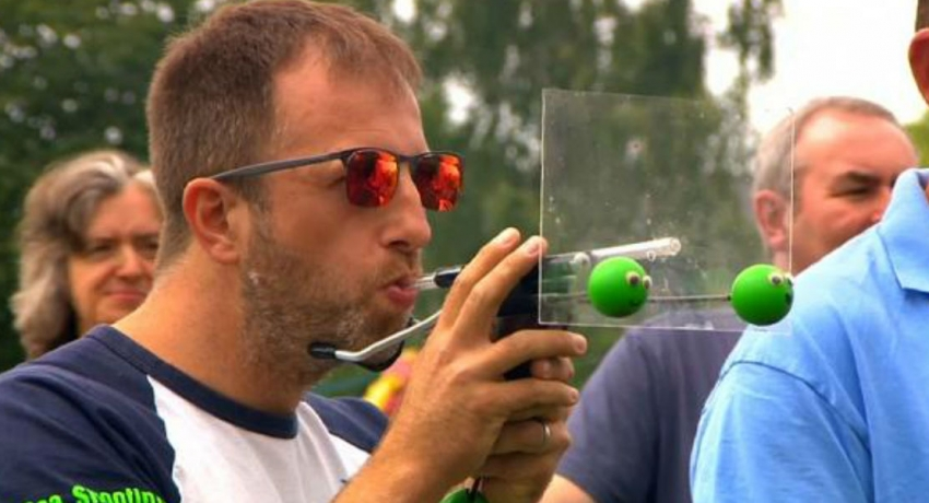 Defending pea shooting champion puffs a winner in world contest