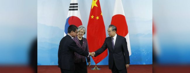 China, Japan, South Korea foreign ministers meet in Beijing amid strained ties