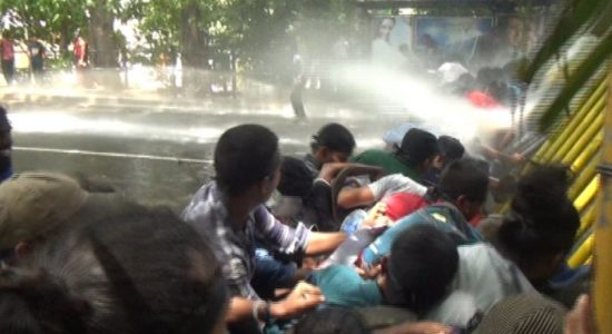 Police fire tear gas and water cannons at protesting university students