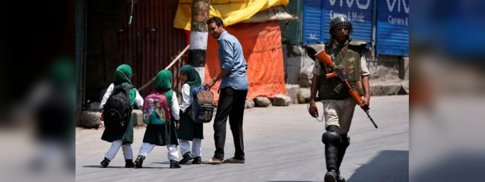 Kashmir schools, offices reopen amid tight security