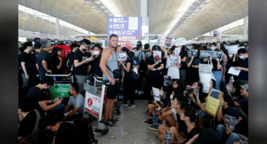 Hong Kong protests: Airport cancels flights as thousands occupy