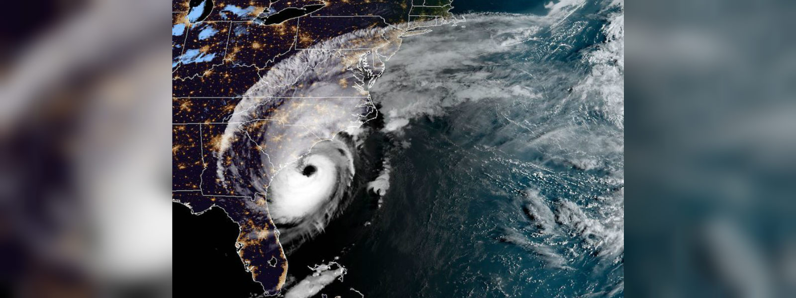 Tornado spins through North Carolina, hurrican Dorian remains close