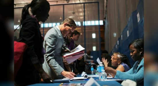 U.S. job growth slows further; wages, hours pick up
