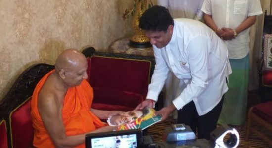 1st copies of Sajith's manifesto presented to Malwathu and Asgiri chief prelates