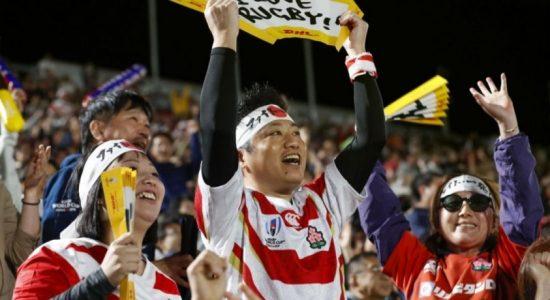 Japan fans beaten but still proud