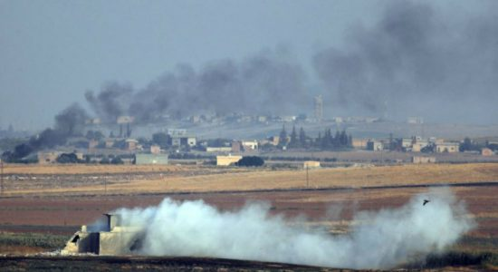Bombardment in border town as Turkey pushes offensive in Syria