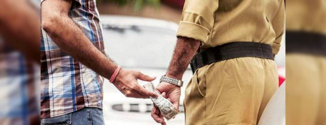 Suspect arrested while attempting to bribe police officer