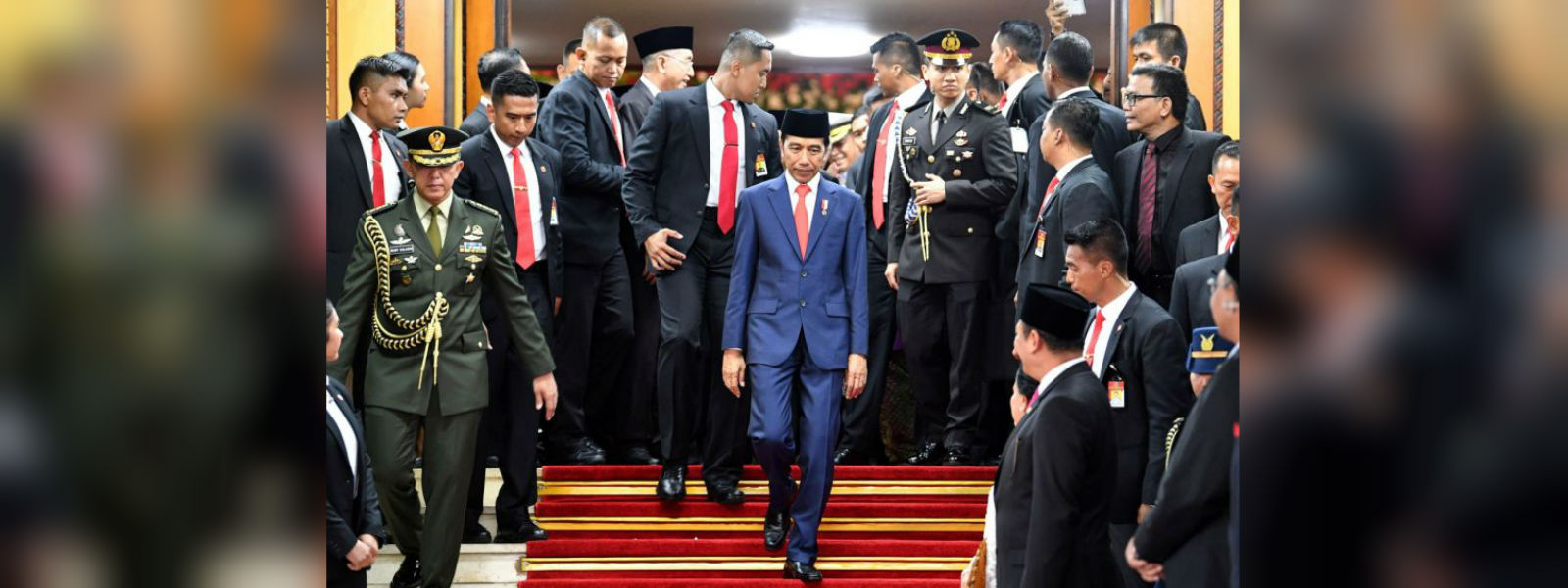 Indonesia cabinet unveiled, includes president's main rival