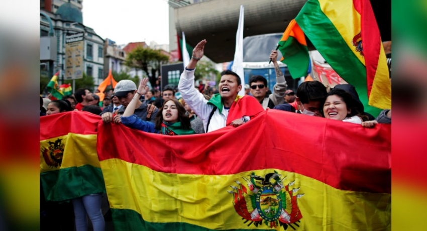 Protesters burn ballot boxes after Evo Morales win sparks allegations of fraud
