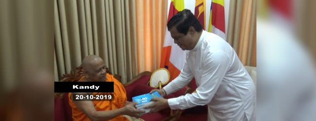 Books authored by Bandula Gunawardena presented to Asgiriya chief prelate