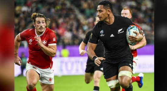 New Zealand fans applaud their team after crushing Canada