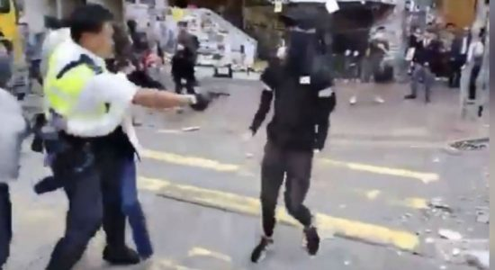 Hong Kong police defends move to shoot, to probe man set on fire