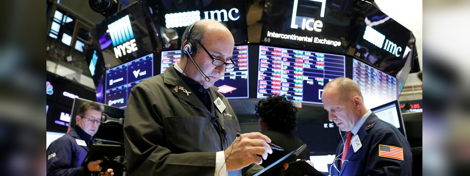 Wall Street climbs to records, fueled by trade comments