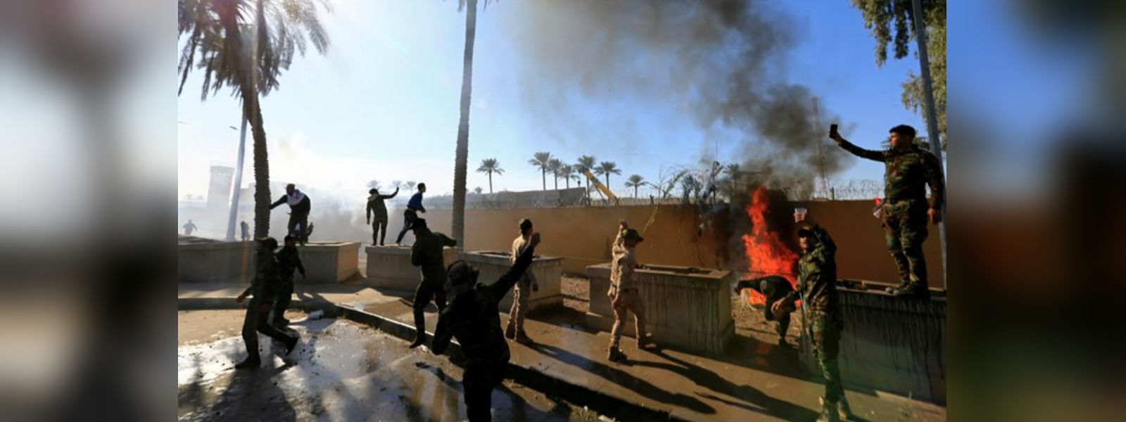 Protesters set fire to US embassy in Baghdad