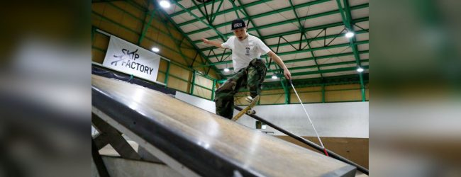 Blind Japanese skateboarder uses cane to ride the rails