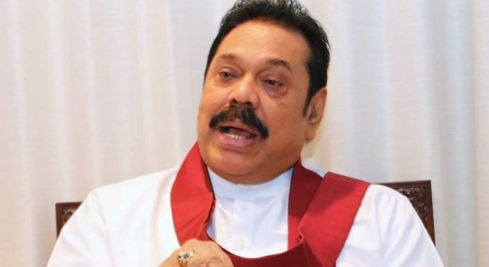 Prime Minister Mahinda Rajapaksa listens to request of 6 year old boy
