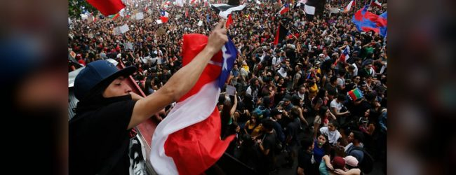 Thousands of Chilean protesters welcome 2020