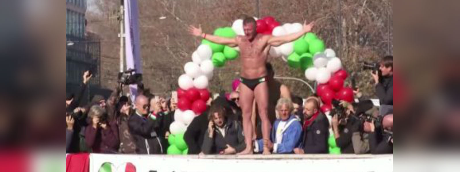 Italians dive into the icy waters of the Tiber River to celebrate the arrival of 2020
