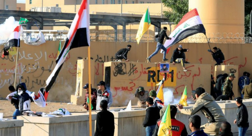 Iraqi militias withdraw from U.S. Embassy