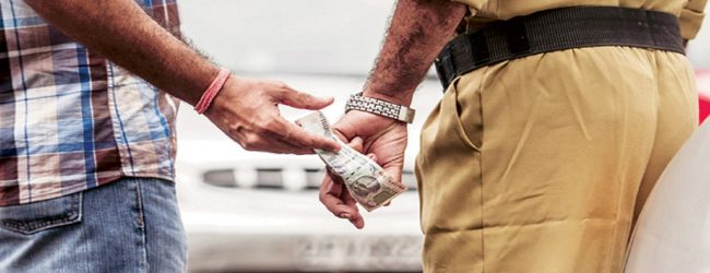 Police sergeant arrested for soliciting a bribe