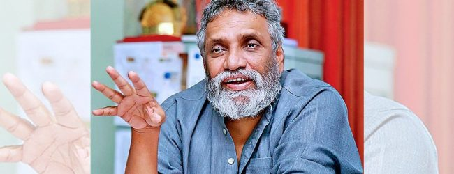 New voting program for quarantined people: NEC Chairman Mahinda Deshapriya