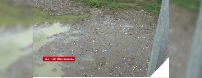 Trash piles up along Mahaweli River banks, as water retreats following heavy rain