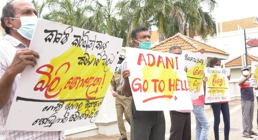 PROTEST OPPOSITE INDIAN HC AGAINST ADANI GROUP