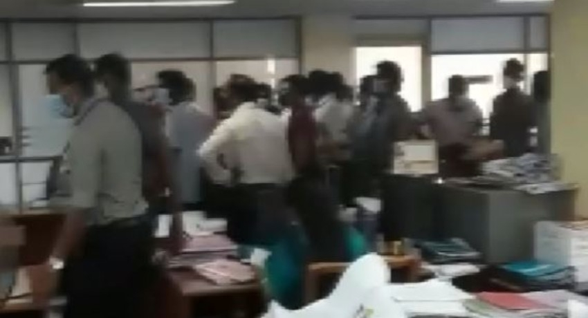 Protest at Exams Dept. against delayed OT payment