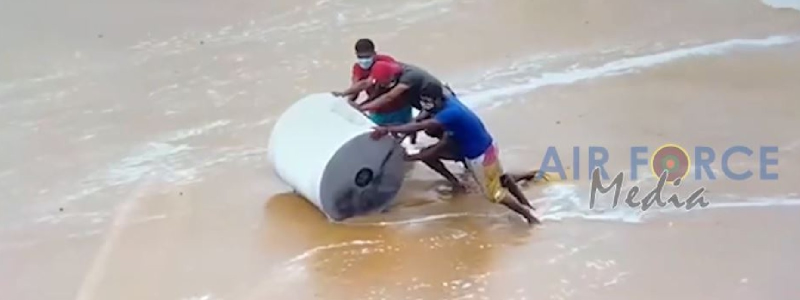 (VIDEO) Air Force drops 850 kg of DCP on burning ship; people rush to collect debris