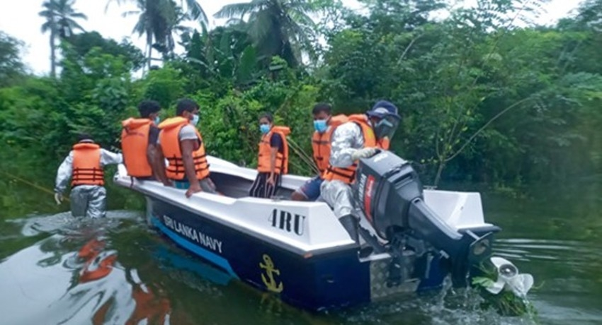Navy relief teams continue to reach out to people affected by floods