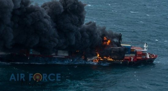 (VIDEO) Air Force drops Dry Chemical Powder onto burning container ship