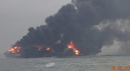 (VIDEO) Debris from burning ship washes ashore; Air Force Drops DCP to contain fire