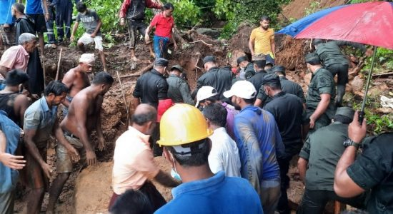 (PICTURES) Army recovers body of landslide victim during rescue operation