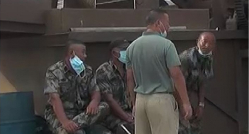 Who are the camo-clad foreigners at JV site?