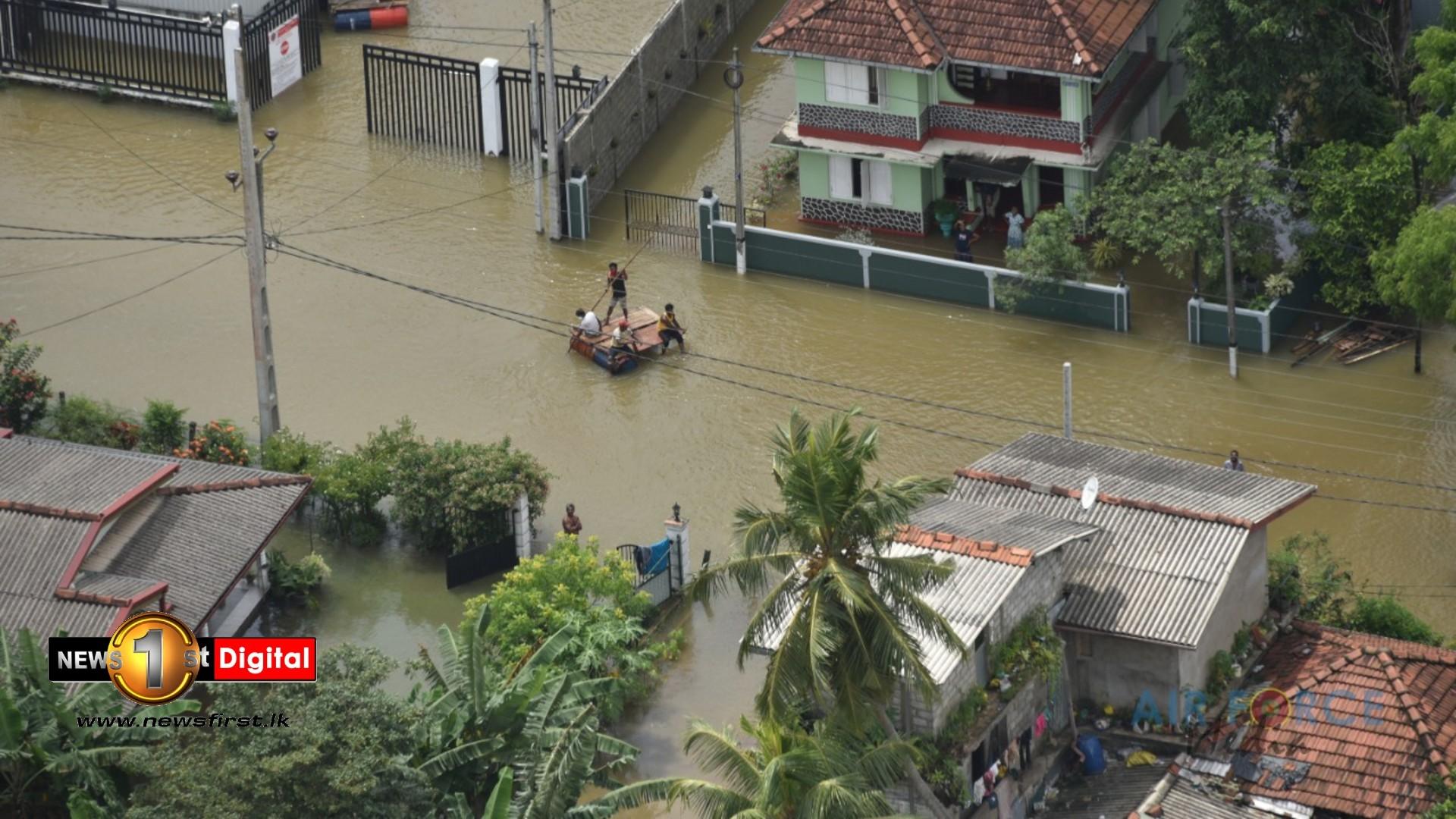 (PICTURES) SLAF reconnaissance mission evaluates flood situation