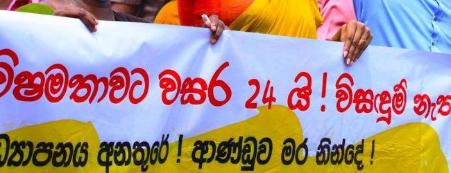Teachers & Principals continue protests as Govt. says it will consider pay rise in next budget