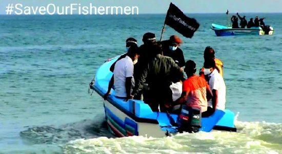 Hundreds of fishermen launch their boats to defend 'Sea of Sri Lanka'